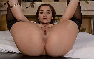 Dani Daniels in black nylons and high heels showing off tight twat