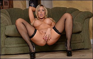 Capri Cavanni in fishnet stockings and black high heels teasing with tight body