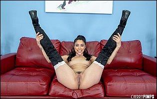 Latina beauty Vanessa Sky in sexy boots posing for camera