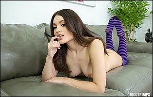 Liv Wild in purple high socks likes posing for camera