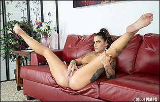 Hot brunette Trinity Blaze getting nude and dildoing her pussy on couch