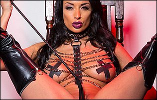 Hot mistress Anissa Kate in sexy fetish outfit posing and spreading legs