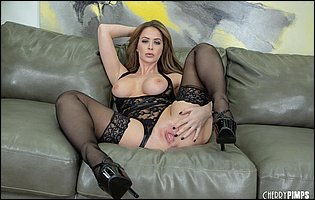 Emily Addison in black lingerie and stockings showing off hot body