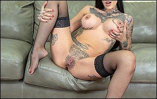 Janey Doe posing in black underwear, stockings and high heels