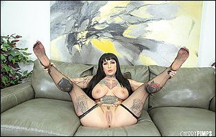 Jessie Lee in black lingerie and stockings posing and spreading legs