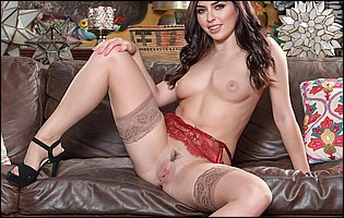 Gorgeous brunette Keira Croft posing in red lingerie, sexy nylons and heels