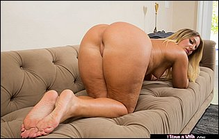 Candice Dare strips and poses naked on sofa