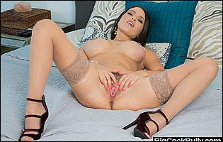 Krissy Lynn in stockings and heels posing for your pleasure in bedroom