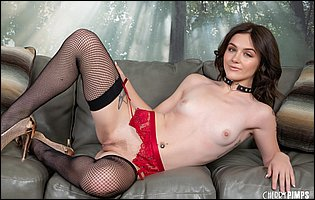 Rosalyn Sphinx posing in red underwear, black stockings and high heels