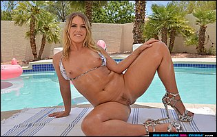 Candice Dare in bikini and high heels exposing hot body by the pool