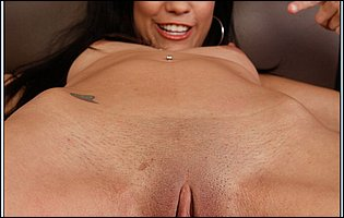 Lusty brunette Tia Cyrus posing and sensually touching her bald pussy