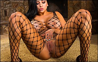 Audrey Bitoni in body fishnet and black high heels teasing with hot body