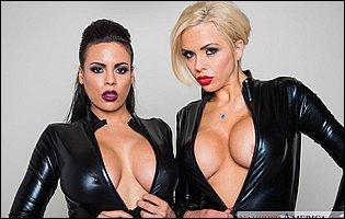 Luna Star and Nina Elle in black leather bodysuit strip for camera