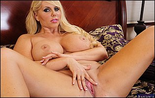 Big titted blonde Karen Fisher stripping and exposing amazing body
