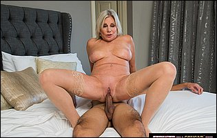 Hot mature blonde Payton Hall seduces young guy