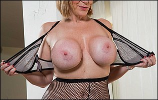 Sara Jay strips off her sexy black underwear and pantyhose