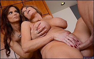Horny mature ladies Darla Crane and Syren Demer seduce their co-worker