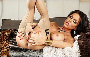 Jessica Jaymes in sexy lingerie and nylons presents her amazing body